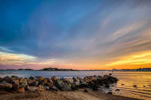 clinton clintontownbeach connecticut hdr longislandsound nikon nikond5300 outdoor beach blue clouds evening geotagged ocean orange outside rocks sand seascape seashore shore sky sunset water