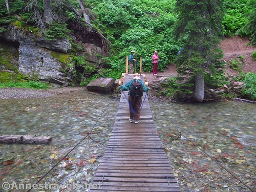 Crossing the swinging bridge en route to Grinnell Lake, Glacier National Park, Montana