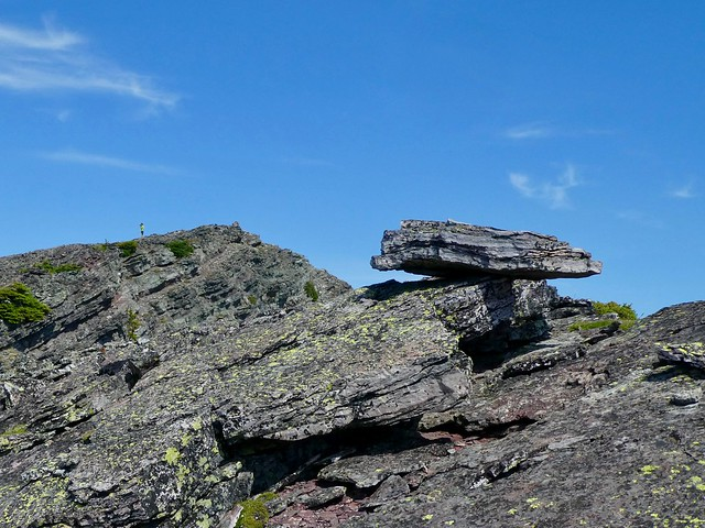 Bertha Peak Summit Scramble - A balancing rock on the summit ridge, another hiker already at the summit in the distance