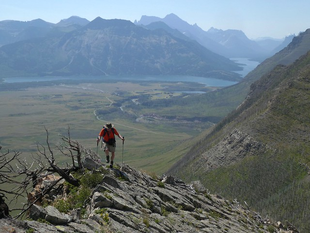 Bellevue Hill Summit Scramble - Ben on the ascent ridge, with views of the Waterton Lakes from the ascent ridge
