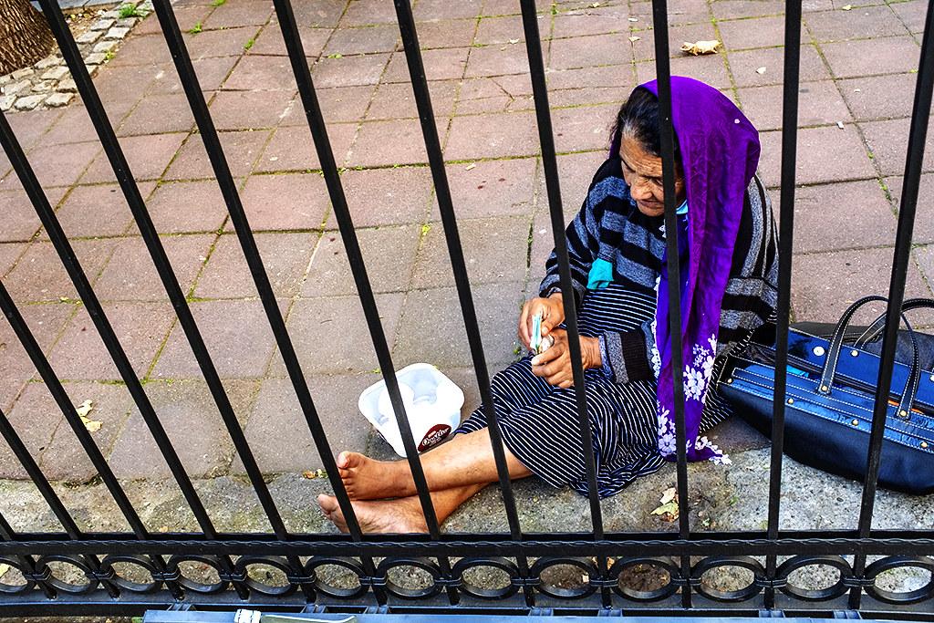 Beggar woman just outside the gate of Bajrakli Mosque--Belgrade