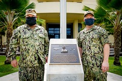 Capt. Bret Grabbe, right, and Capt. Tim Poe, pose for a photo in front of Konetzni Hall after the CSS-15 change of command ceremony. (U.S. Navy/MC2 Kelsey J. Hockenberger)