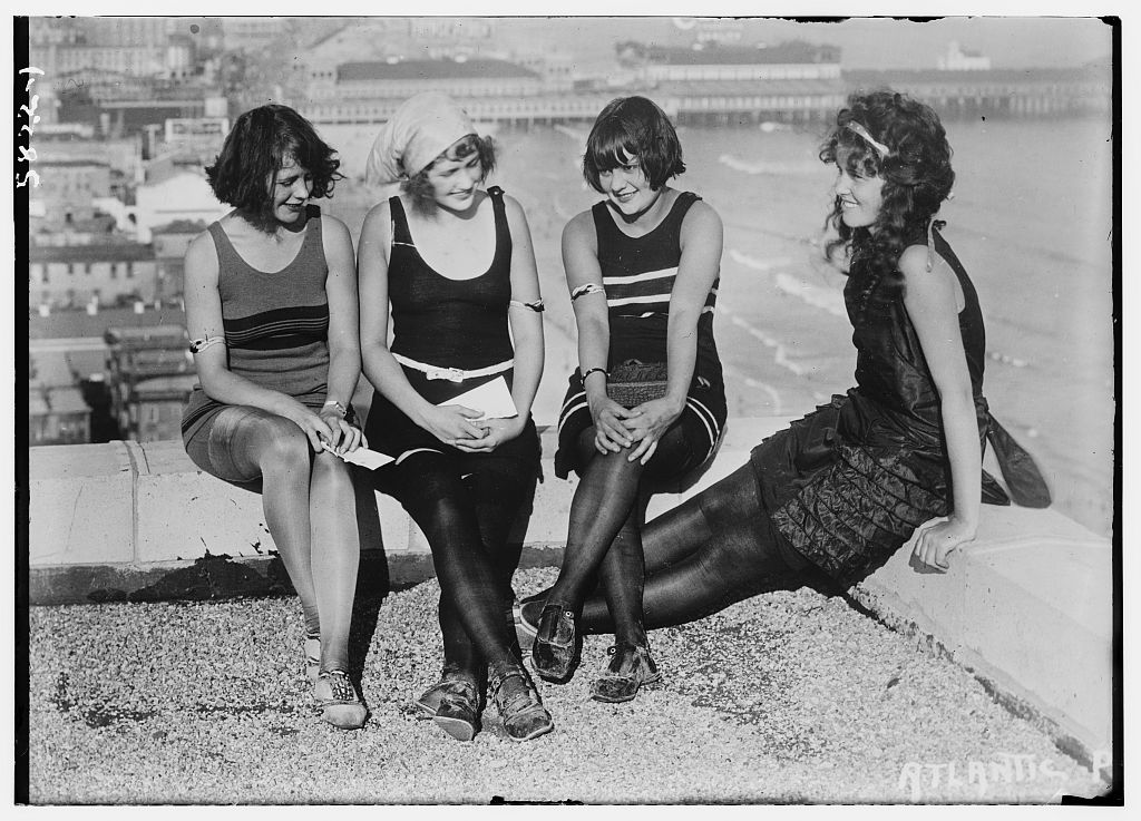 4 young ladies on a roof (LOC)