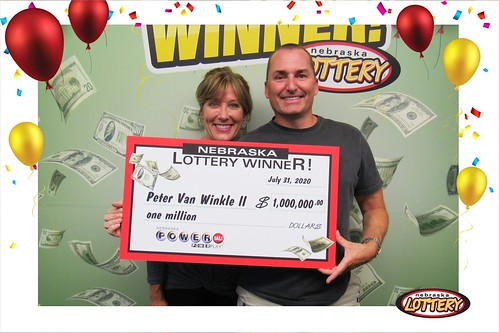 Tammy and Peter Van Winkle of Grand Island hold up a large check for $1 million