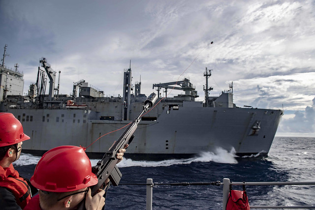 The USS Shiloh conducts a replenishment at sea with the USNS Alan Shepard while underway in the East China Sea