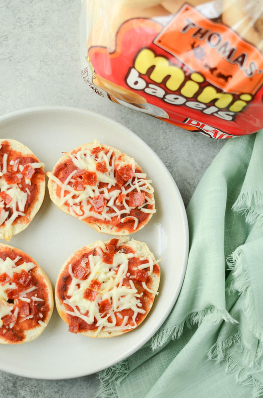 Mini Pizza Bagels - make your own bagel bites! Mini bagels topped with pizza sauce, cheese, and pepperoni. Freezer instructions included!