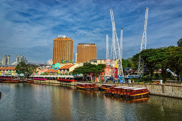 Clarke Quay with tourist bum boats on the Singapore River