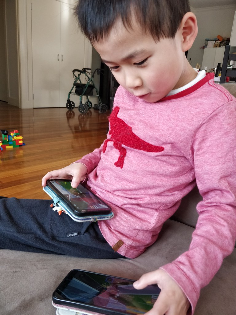 Liam playing Roblox with Isaac's phone as well
