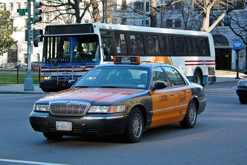 Taxicab and Metrobus on I Street NW | by SchuminWeb