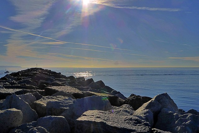 Sun kissed rocks and sea - Sitting on the dock of the bay