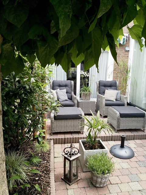 Kunststof tuinstoel met hocker