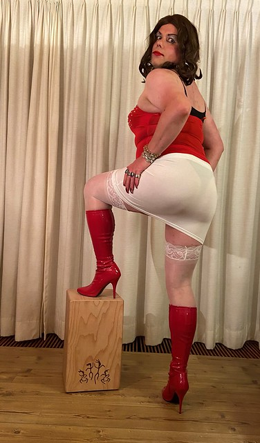 white stockings and red boots, a white skirt and red top combination