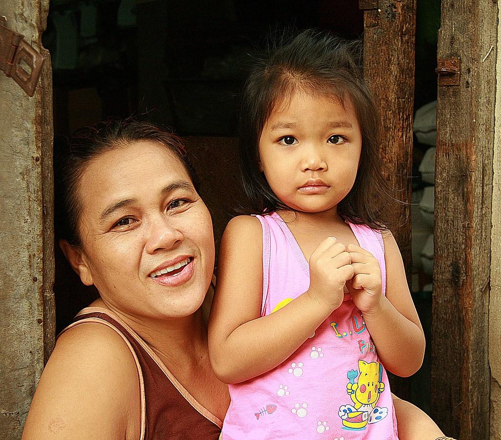 mother and daughter in their doorway