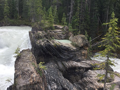 Unusual rock formations at Kicking Horse Natural Bridge Falls in Yoho National Park in BC, Canada