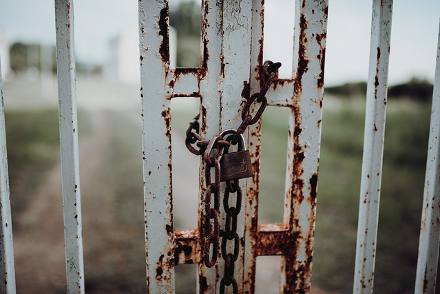 Rusty chain with a padlock