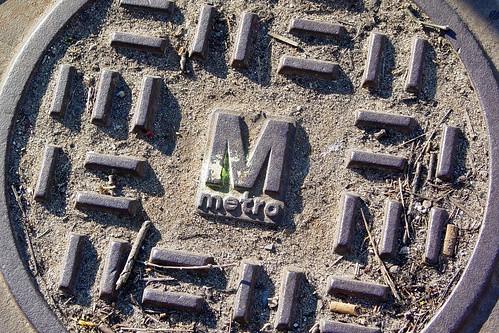 Metro manhole cover outside Forest Glen station