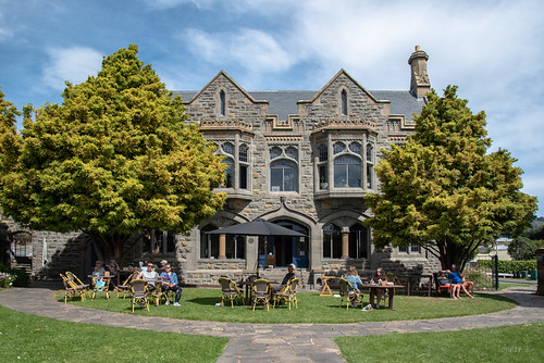 newzealand christchurch signofthetakahe cafe restaurant trees people architecture building tables chairs clouds sky abigfave