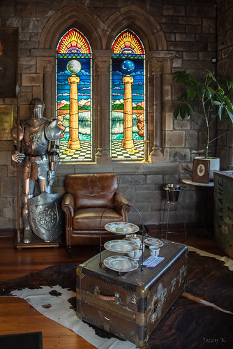 interior newzealand christchurch signofthetakahe cafe restaurant lights people architecture building stainglass window plant chest plates suitofarmour mat chairs