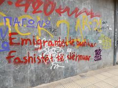 Immigrants united, crush the fascists (slogan in Albanian)