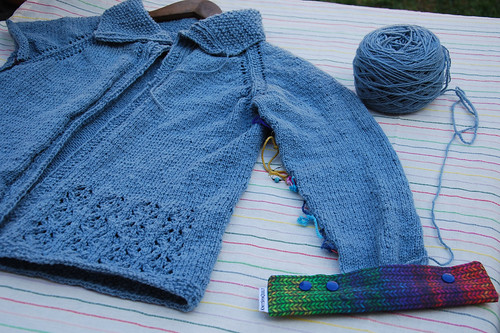 Handknit cardigan with lower lace panel Vodka Lemonade pattern in handspun Polwarth wool indigo dyed work in progress with double point needle holder