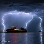 1. August 2020 - 0:25 - A container ship is leaving the port of Antwerp, Belgium during a spectaculair lightning show.