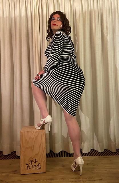 posing in her striped dress again