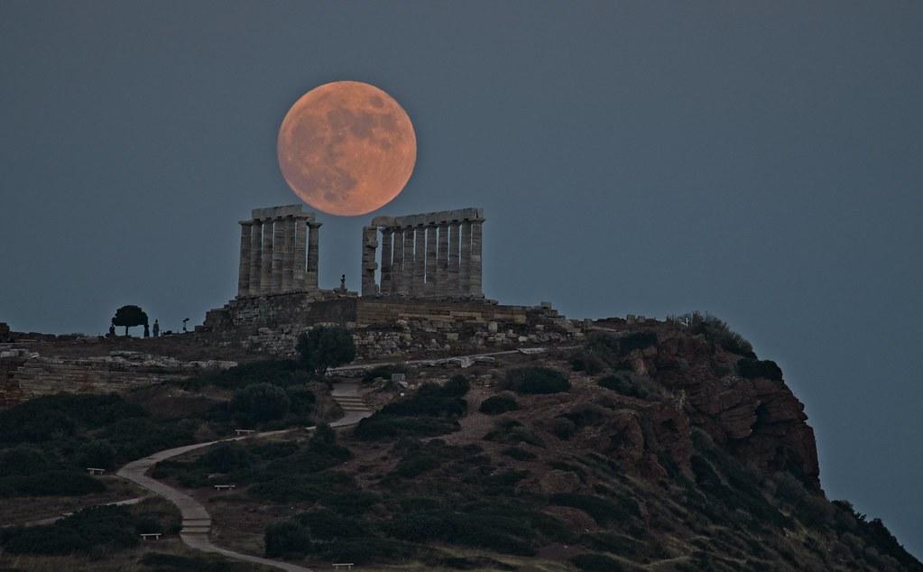 full moon rising over the Poseidon temple