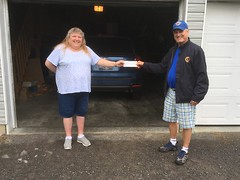 Lion Bill Garland presenting a cheque for $1,500 to Rozalyn Decaire of Verona for winning the Lions' Spring Draw.  Congratulations Rozalyn.  Thank you to all the people that support this draw.