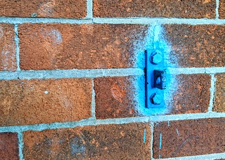 Strange blue sprayed wall mount | by Tony Worrall