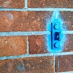 Strange blue sprayed wall mount