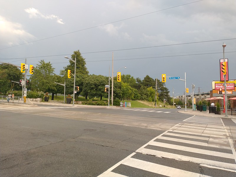 Looking southeast across St. Clair and Caledonia Road #toronto #stclairavewest #stclairave #caledoniaroad #intersection #grey #green #blue #clouds #evening