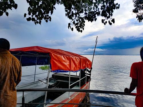 singleboat boat boatman water people white cloud beauty afternoon friends