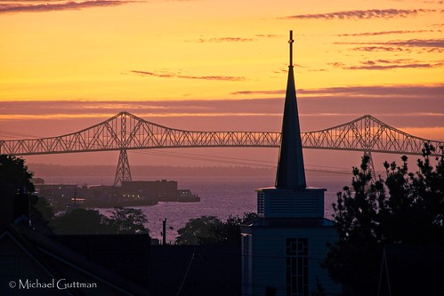 astoria oregon columbiariver astoriameglerbridge sunset bridge river sunsetcolors sunsetsky silhouette churchsteeple