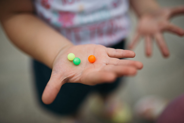 Toddler holding colorful candy.