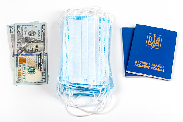 Money, medical masks and passports on a white background