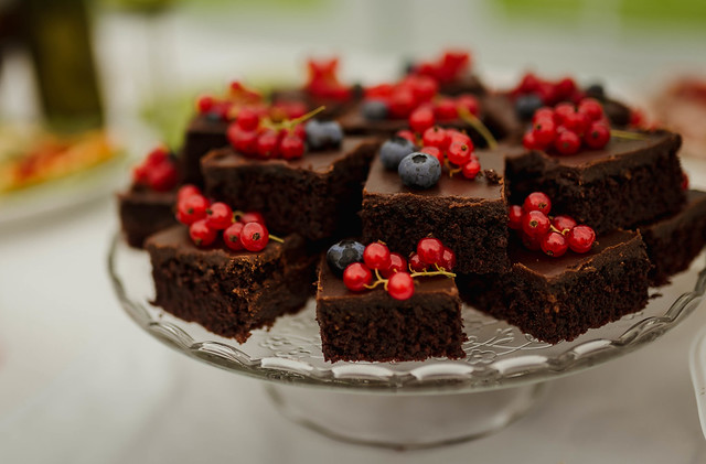 Chocolate Brownies With Berries On The Table