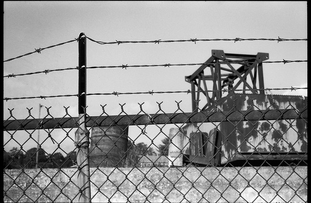 barbed wire, metal fence, industrial architecture,  railroad district, Asheville, NC, Minolta XG-M, Fomapan 200, Moersch Eco film developer, 8.1.20
