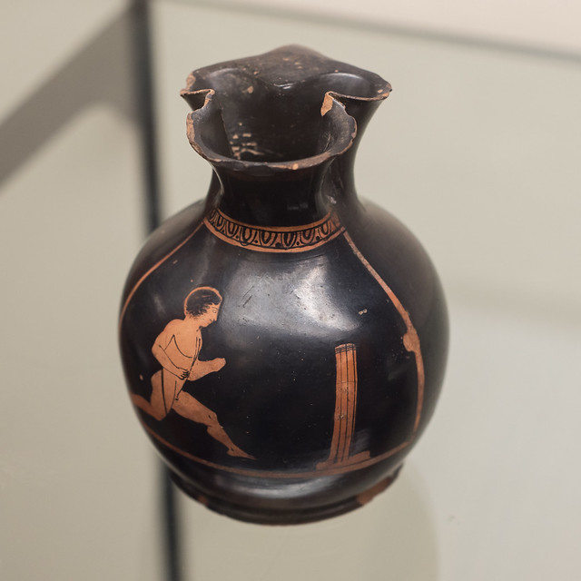 Athenian Red Figure chous with representation of a boy racing with a turning post
