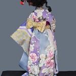 Ariadne in lilac kimono with cherry blossoms and clouds.