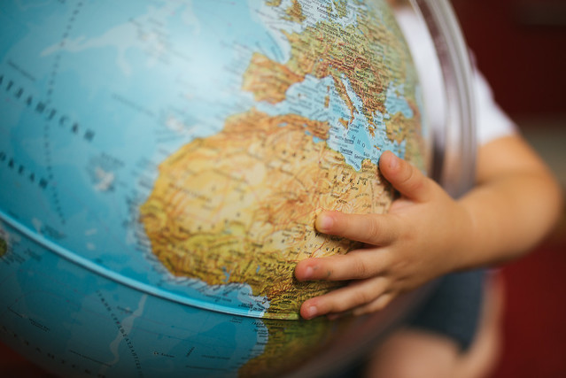 Girl holding a globe closeup.