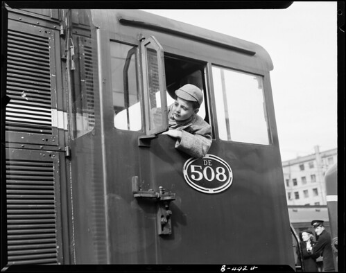 <p>On August 30 1954 this photo was taken of a schoolboy leaning from drivers cab of De 508 <br /> <br /> Archives New Zealand Reference: AAVK 6390 181 B4924<br /> <br /> Material from Archives New Zealand Te Rua Mahara o te Kāwanatanga</p>
