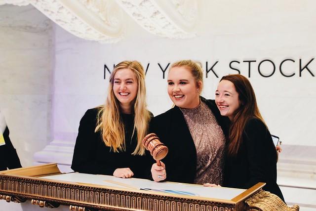 Three Auburn University students at the New York Stock Exchange