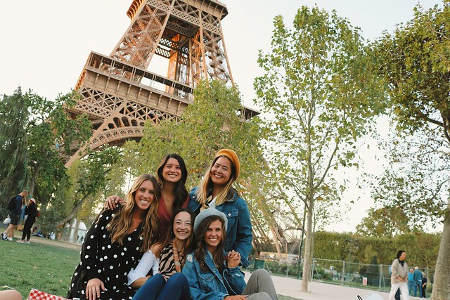 Five female students in front of Paris' Eiffel Tower