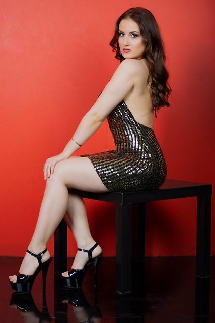 Black Heels Red Background Sitting