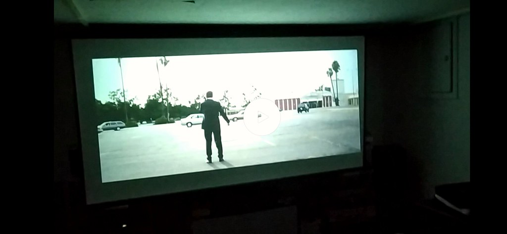 Projector in white room