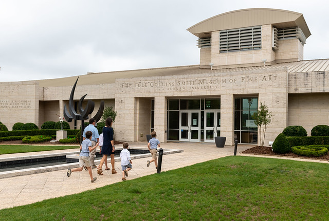 A family enters the Jule Collins Smith Museum of Fine Art