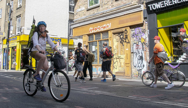 DSC_5422a Brick Lane London Lady Cyclist with Backpack