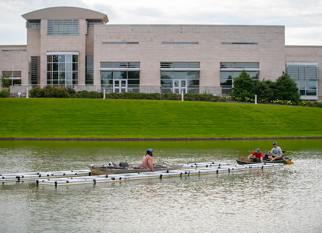 Auburn graduate students working in the museum pond