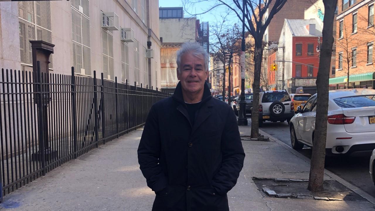 Stewart Till standing outside in the street