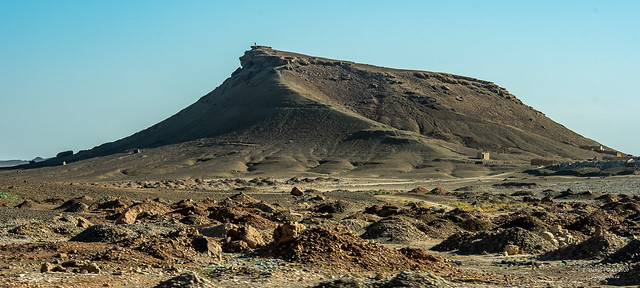Man standing at the tip of the big rock - Atlas Mountains, Morocco